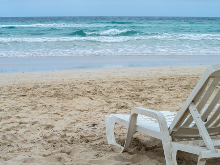 Overcast beach in the Caribbean with a sun lounger and no people Stock Photo