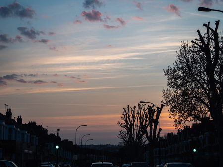 Pink and blue sunset sky over commuters in London