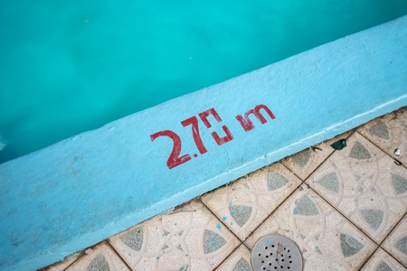 Swimming pool with 2.70m depth marker painted in red Reklamní fotografie