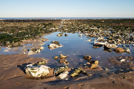 Rocks on the beach with tidal pool in Kent, UK