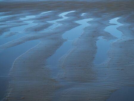 Detail of rippled wet sand on New Brighton beach, New Zealand