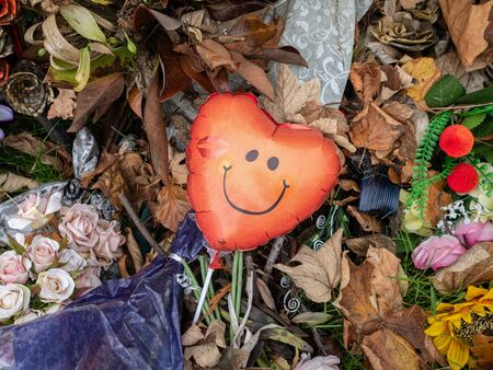 CHRISTCHURCH, New Zealand - MAY 2019: Red heart balloon with smiley face among tributes at the mosque shooting memorial Editorial