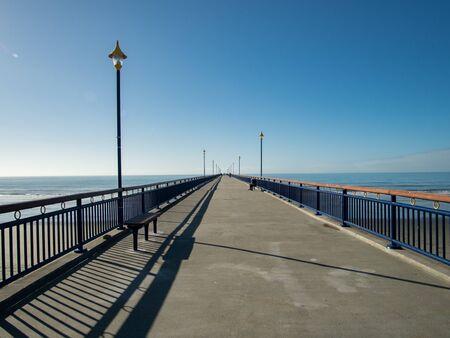 View along New Brighton pier, New Brighton beach, New Zealand Standard-Bild