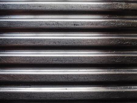 Scratched silver ridged corrugated metal panel Stok Fotoğraf