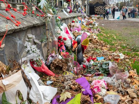 The mosque shooting memorial in Christchurch, New Zealand, outside the botanical gardens. The flowers and tributes are fading with time