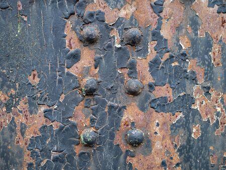 Cerrar detalle de herrajes pintados remachados oxidados Foto de archivo