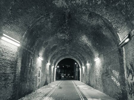 Old railway arch tunnel used as a footpath in Deptford, London