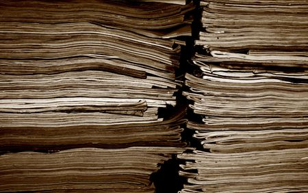stack of documents: Stack of old magazines in sepia tones