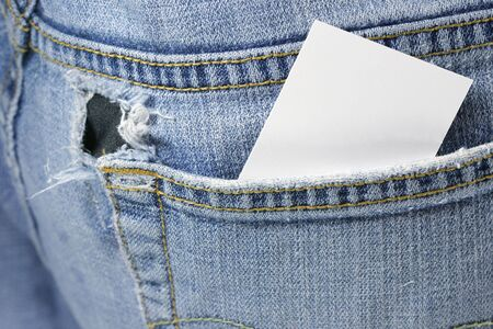 Blank card in back pocket of torn jeans Stock Photo - 2667214