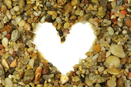 Heart shape out of small rocks photo