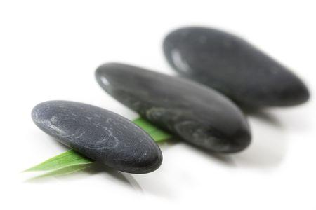 Three stones on a leaf photo
