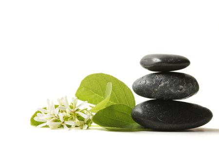 alternative wellness: Stacked stones with flower Stock Photo