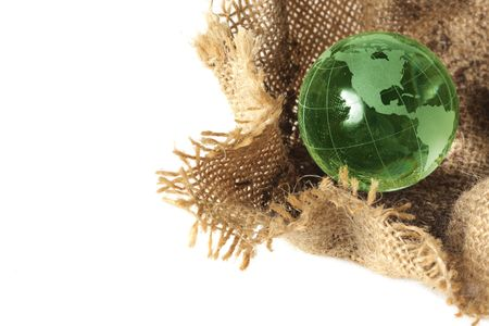 Glass globe in burlap sack photo