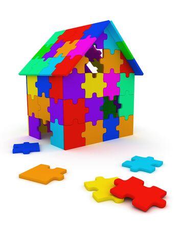 puzzelen: Huis gebouwd uit kleurrijke puzzel stukjes Stockfoto