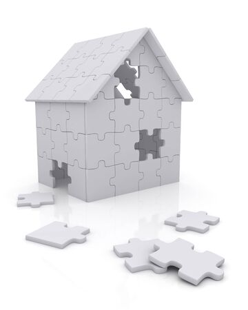 house construction: House built out of puzzle pieces