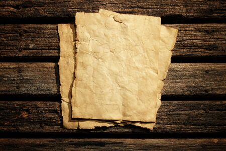 old wood floor: Old paper on wooden wall
