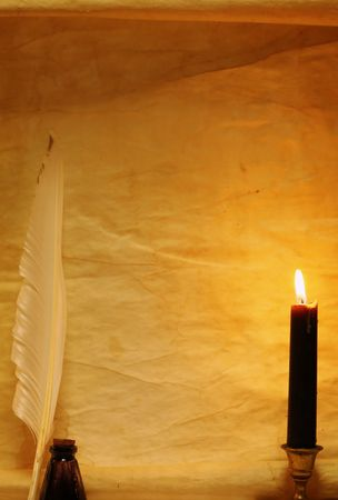 Paper, quill, & ink lit by candle