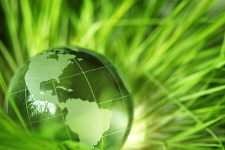 Glass earth in grass photo