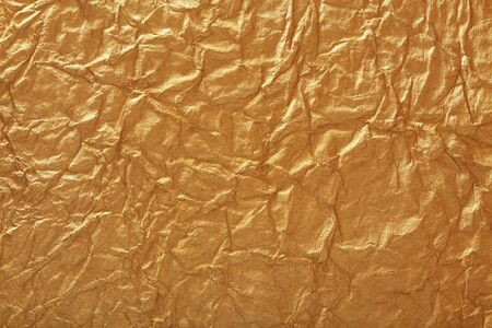Crumpled gold paper Stock Photo