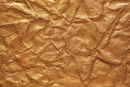Crumpled gold paper Reklamní fotografie