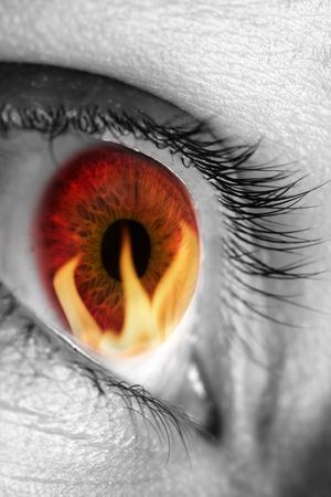 satan: Red eye refecting fire Stock Photo