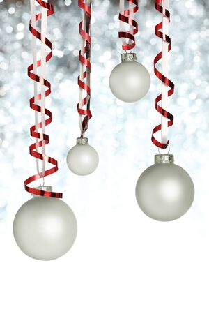 silver background: Hanging Christmas ornaments