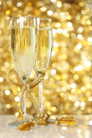 Champagne flutes with golden background photo