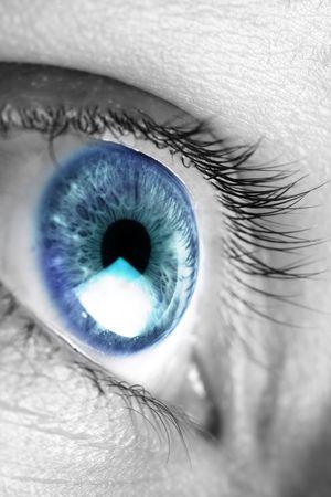 Bright blue eye closeup photo