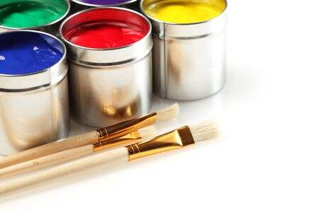 Cans of paint with paintbrushes photo