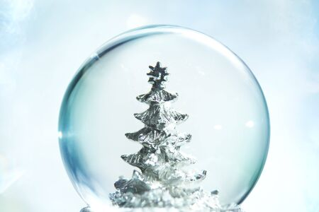 crystal background: Snow globe with Christmas tree Stock Photo