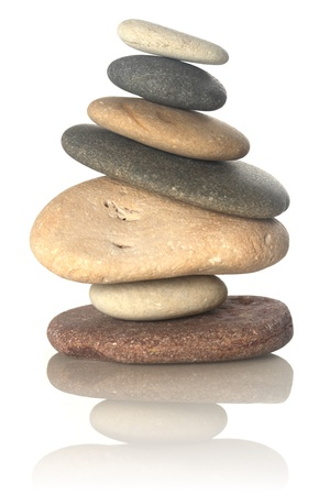 smooth stones: Stacked stones isolated on white Stock Photo
