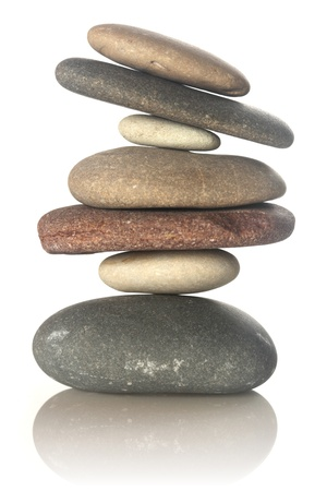 zen stones: Stacked stones isolated on white Stock Photo