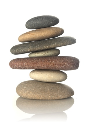 heap: Stacked stones isolated on white Stock Photo