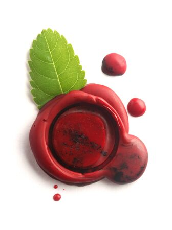 credentials: Red wax seal with green leaf isolated on white Stock Photo