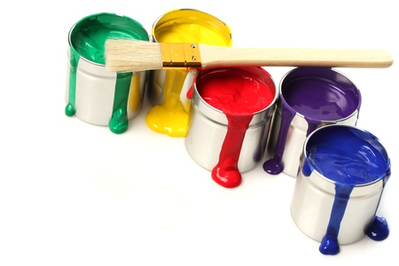 messy paint: Cans of paint with paintbrush Stock Photo