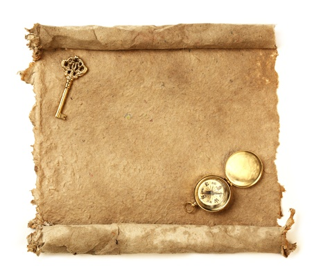 medieval scroll: Handmade paper scroll with key and a compass Stock Photo