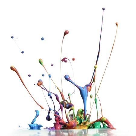 Colorful paint splashing isolated on white photo