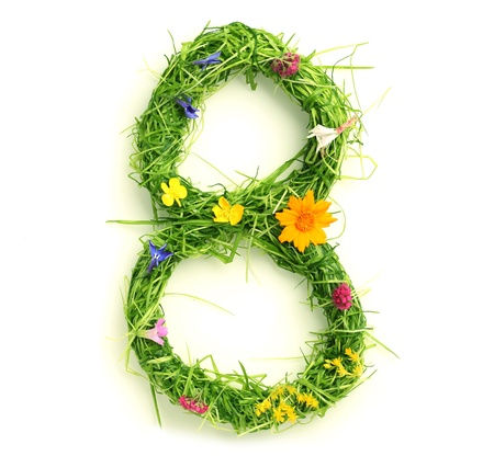 Numbers made of flowers and grass isolated on white