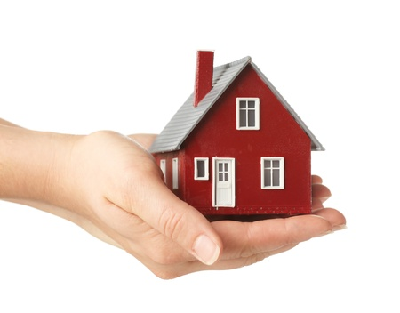 buy house: Hand holding house Stock Photo
