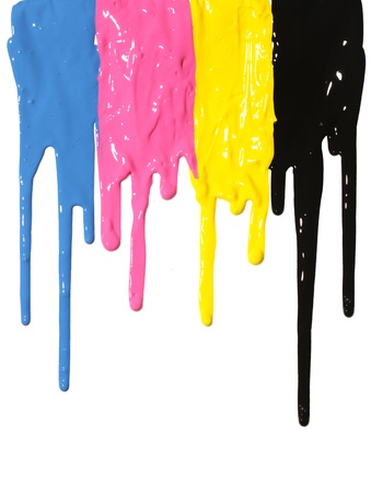 CMYK paint dripping isolated on white photo