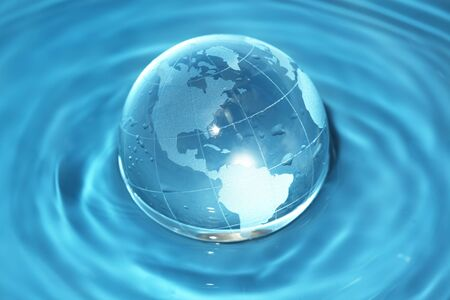 Glass globe in water photo
