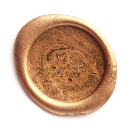 Sello de cera oro aislado en blanco