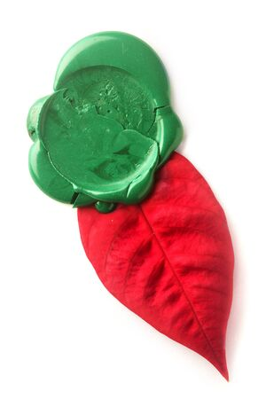credentials: Green wax seal with red leaf isolated on white