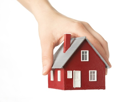 house in hand: Hand holding house Stock Photo