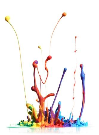 Colorful paint splashing isolated on white 스톡 콘텐츠