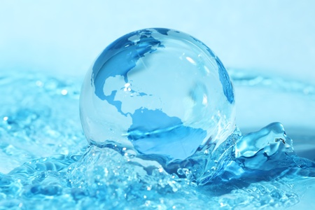 Glass globe in water photo