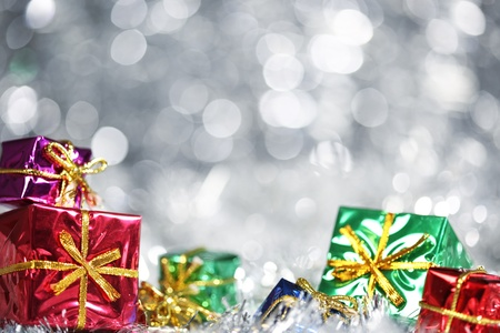 Silver Christmas background with presents photo