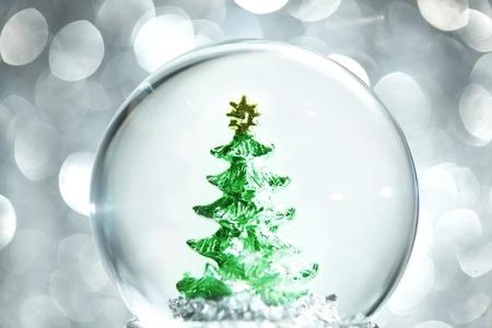 Snow globe with Christmas tree Stock fotó