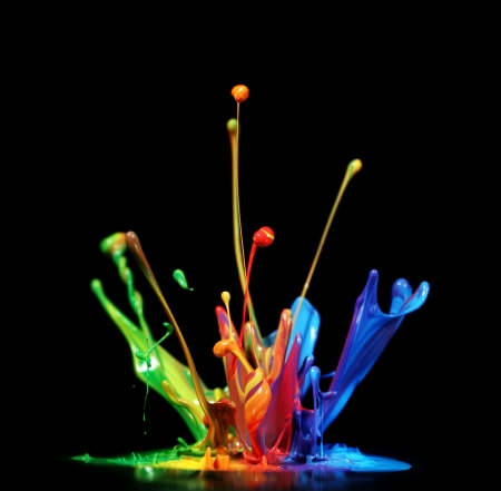 Colorful paint splashing photo