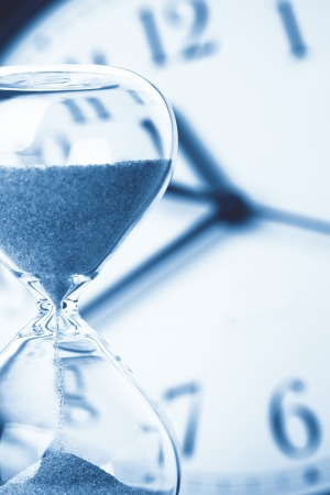 the blue hour: Concept of time - Hourglass and clock